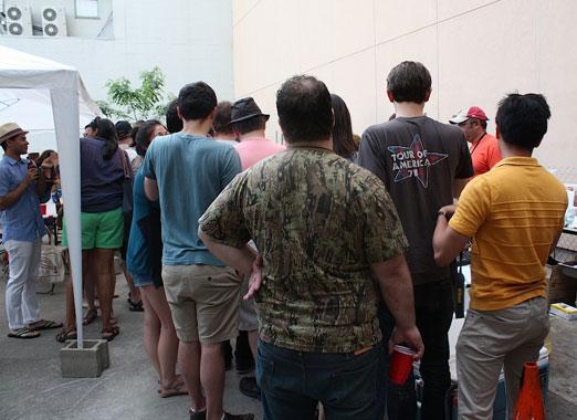 onlookers-from-behind-hog-days-of summer-arrogant-swine-lic-queens