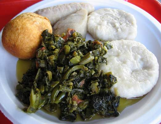 A vegetarian plate of callaloo, fried and boiled dumplings