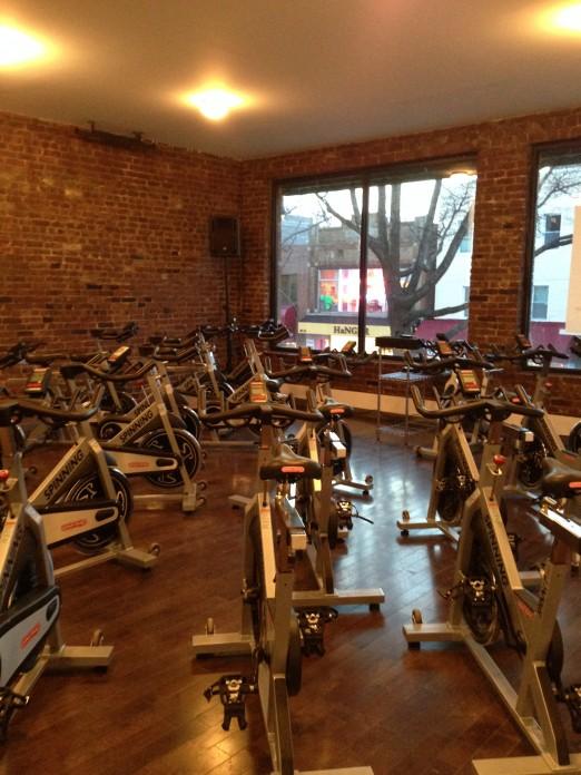 Simply Cycle Astoria_Interior Shot_Bikes with Brick Wall