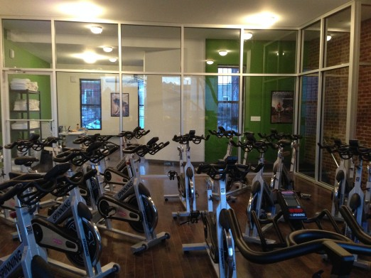 Simply Cycle Astoria_Interior_Bikes with Green Wall