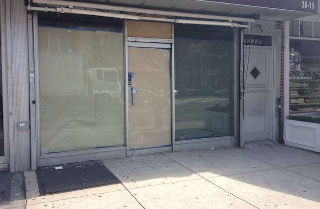 the-brass-owl-papered-storefront-ditmars-astoria-queens