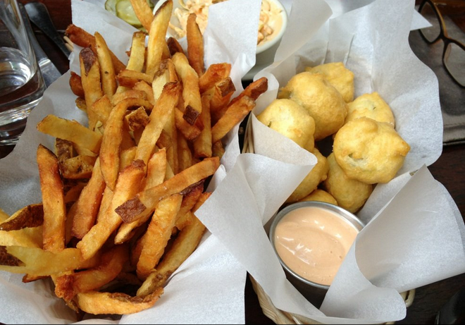 French fries and fried pickles. A match made in heaven.  Photo Credit: Share W. Via Yelp