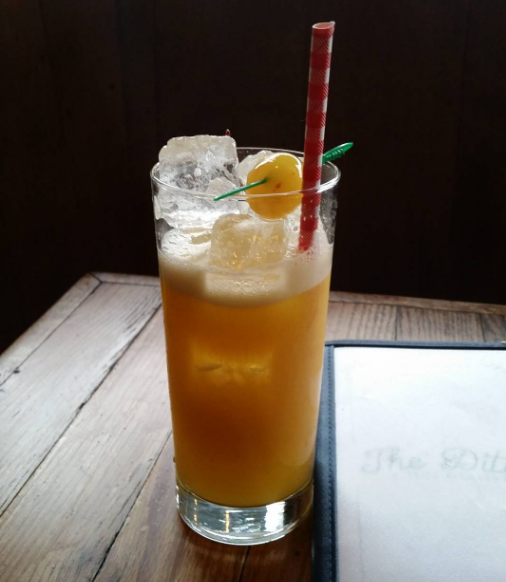 "The Ditty's ""The Whitewalker"": Spiced, White and Over proof Rum, Passionfruit, Pear, and Lime."